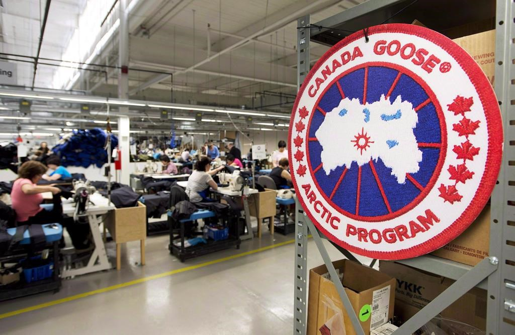 Employees work with Canada Goose jackets at the Canada Goose factory in Toronto on Thursday, April 2, 2015.