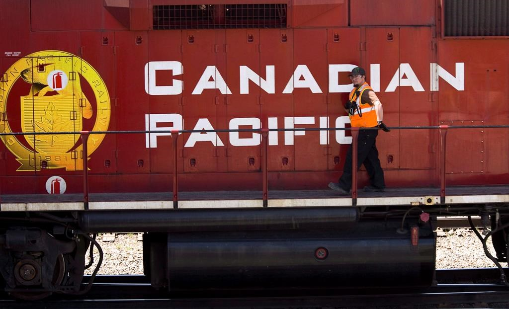 A Canadian Pacific Railway employee walks along the side of a locomotive in a marshalling yard in Calgary, Wednesday, May 16, 2012. Crews are working in cold weather to clean up at the scene of a train derailment in southern Saskatchewan.Canadian Pacific Railway says a number of cars left the tracks late Sunday night near the community of Ernold, about 170 kilomestres west of Regina.