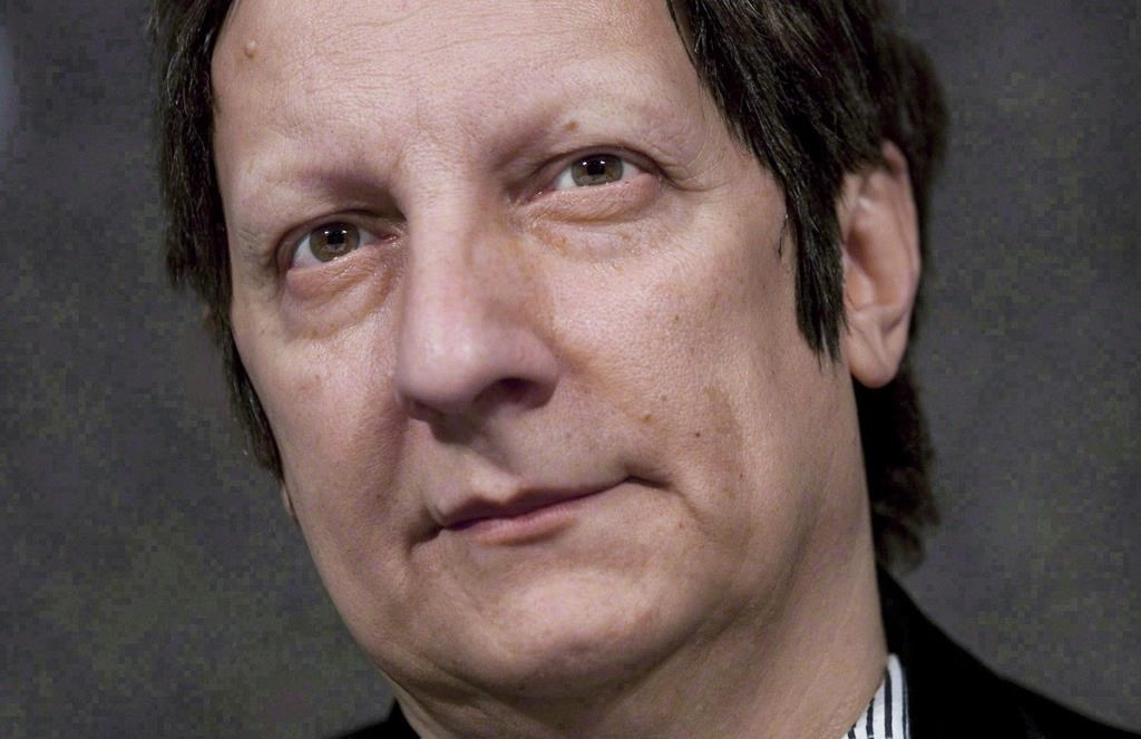 Canadian playwright, actor, film director and stage director Robert Lepage speaks to reporters at the National Arts Centre in Ottawa on November 10, 2010.