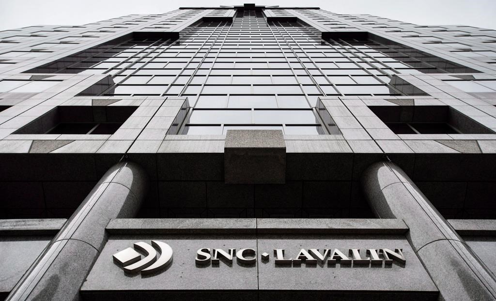 The headquarters of SNC Lavalin is seen Thursday, November 6, 2014 in Montreal. SNC-Lavalin Inc. is eliminating about 100 positions in Canada at the same time as the Quebec engineering firm is being described by political leaders as being vulnerable to a foreign takeover.