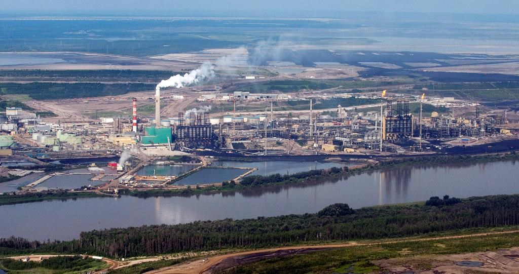 The Suncor mine facility along the Athabasca river as seen from a helicopter tour of the oil sands near Fort McMurray, Alta., Tuesday, July 10, 2012.