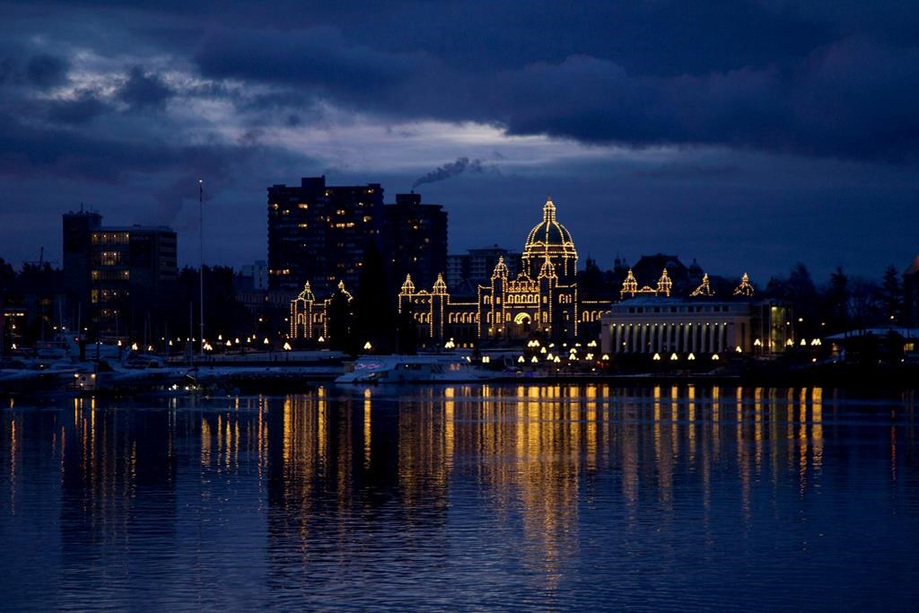 The British Columbia Legislature is reflected in the waters of Victoria harbour in the early morning in Victoria, B.C. Monday, Jan. 16, 2012.