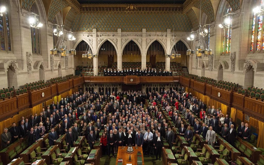 Members of the House of Commons pose for a photo in the chamber before Question Period in the House of Commons Wednesday, December 12, 2018 in Ottawa. Centre block is slated to close for renovations following the fall session.