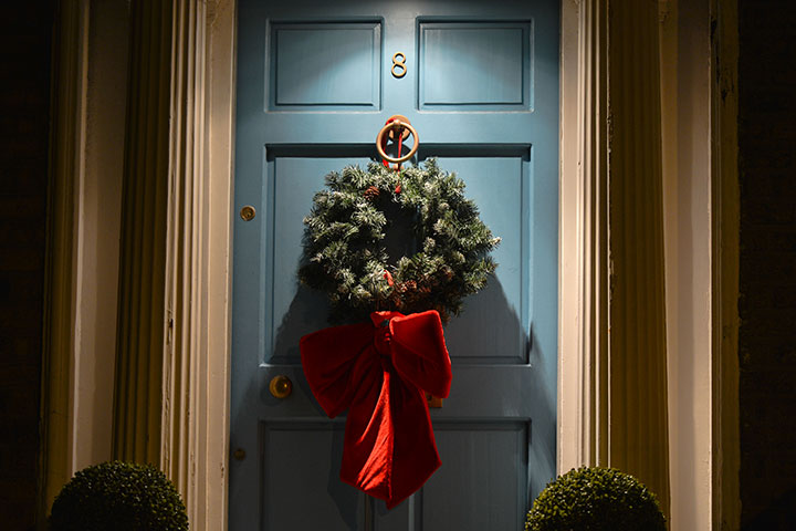 A Christmas wreath seen on a door of a house in this file photo.