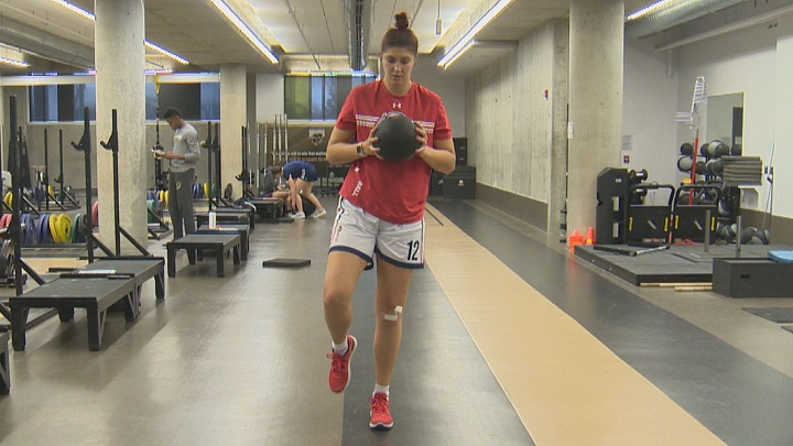 Winnipeg pro basketball player Emily Potter does rehab exercises to heal her injured knee after surgery.