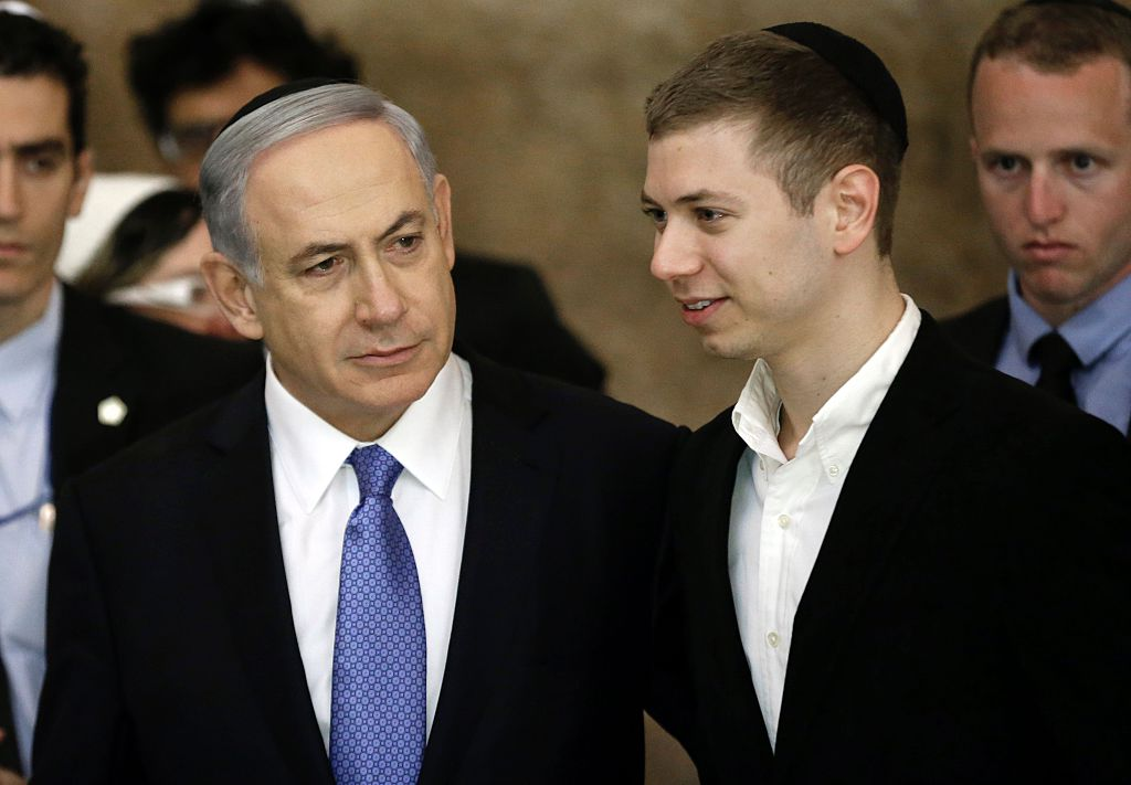 Israeli Prime Minister Benjamin Netanyahu and his son Yair visit, on March 18, 2015, the Wailing Wall in Jerusalem    .