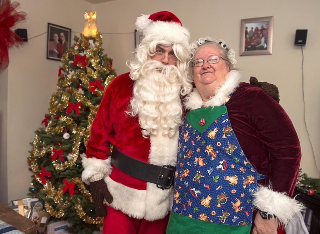 Ted Carroll, a Santa-for-hire, and his wife Kim, as Mrs. Claus, display their outfits in Halifax on Dec. 17, 2018. Professional Santas and their associates across the country are into the busy season as Christmas draws closer.