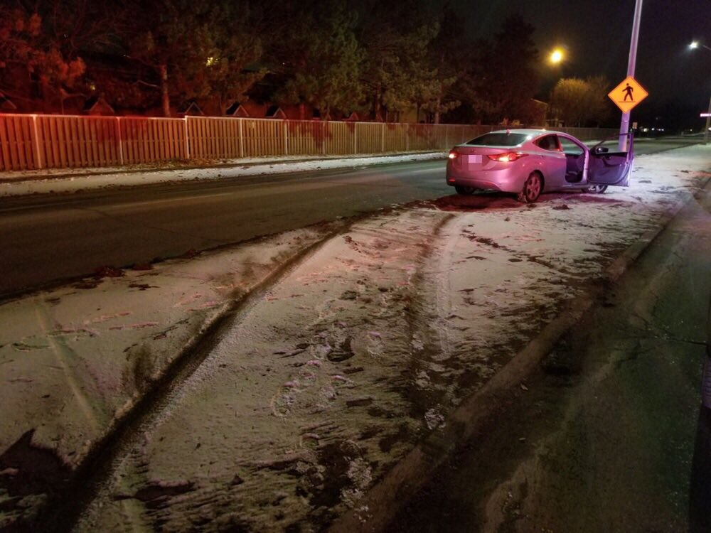 A Kingston woman was charged with impaired driving after she allegedly drove her car over a median.