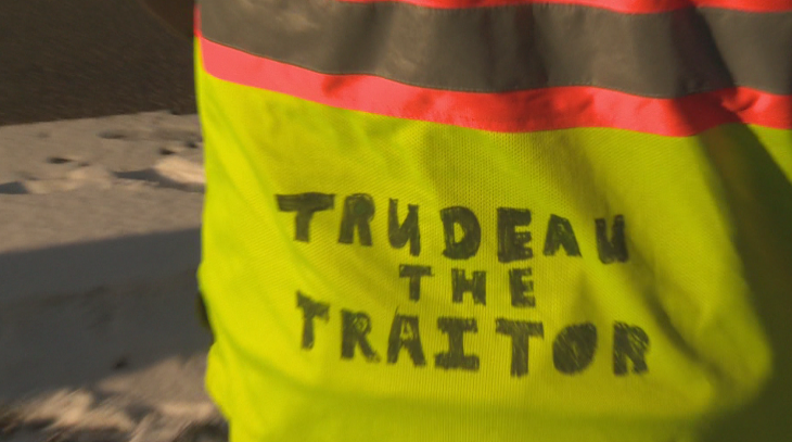 The back of a protester's jacket at the Manitoba legislature on Saturday morning.