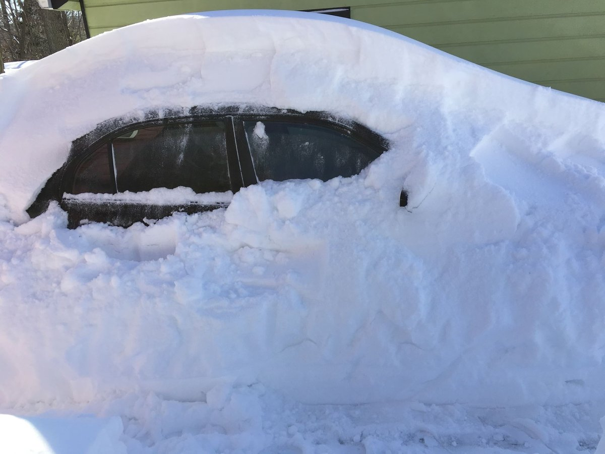 A car is buried in snow.