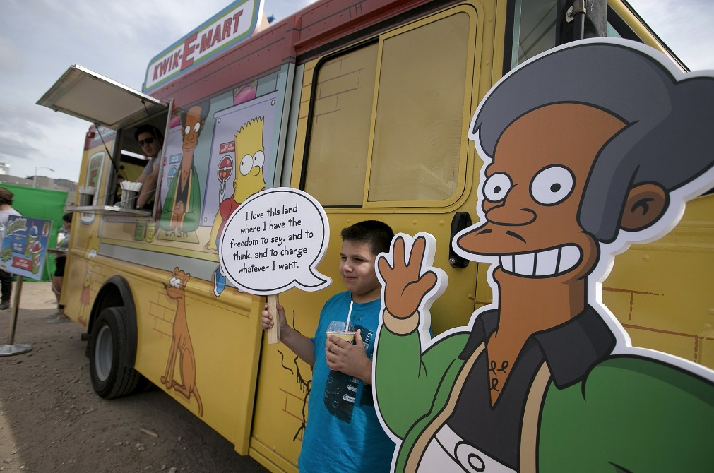 In this March 15, 2015 file photo, an Apu cutout is displayed at a 'Simpsons' Kwik-E-Mart Truck in Austin, Texas.
