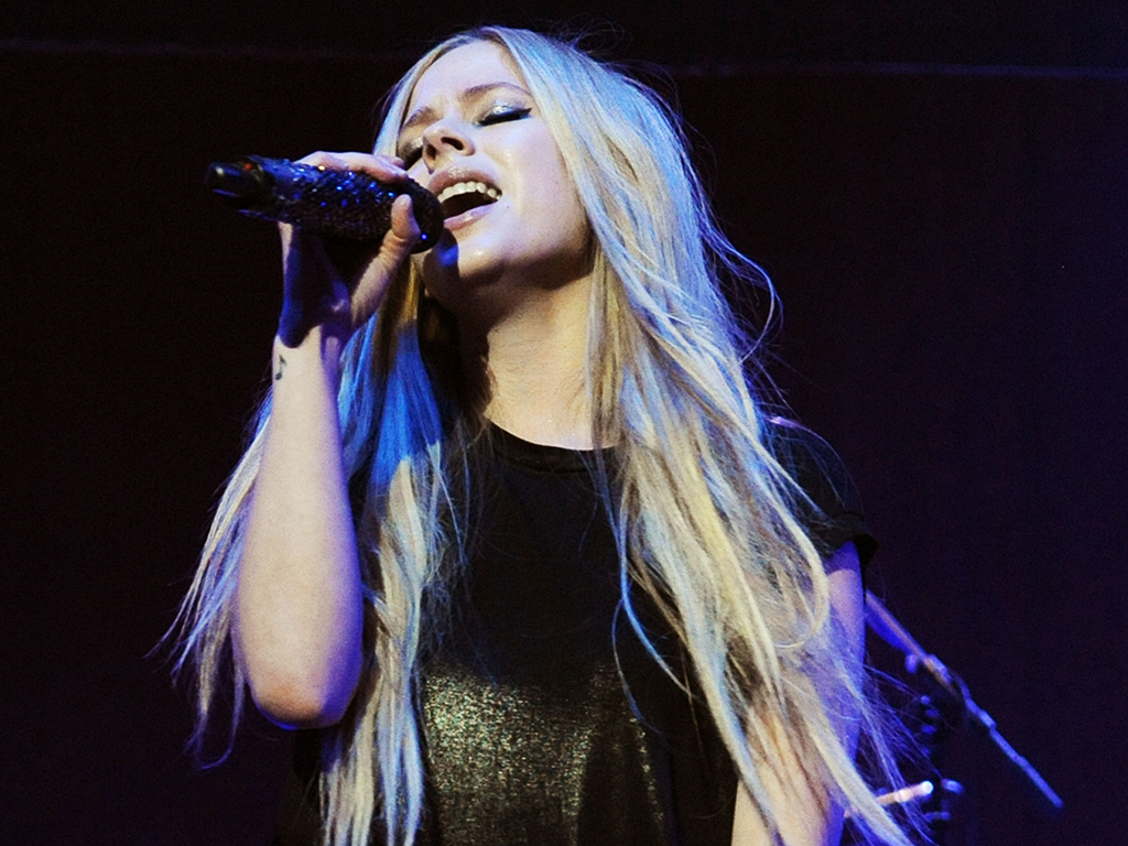 Avril Lavigne performs during the 2013 Star '94 Jingle Jam at the Gwinnett Center on Dec. 16, 2013 in Duluth, Ga.