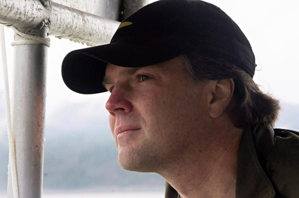 Fin Donnelly, NDP MP for New Westminister Coquitlam and Port Moody looks out from a boat at the site of the proposed Enbridge bitumen terminal on Douglas Channel, south of Kitimat, B.C., on June 27, 2012. New Democrat MP Fin Donnelly says after much thought and reflection, he will not be seeking re-election in 2019. Donnelly has represented the British Columbia riding Port Moody-Coquitlam, previously called New Westminster-Coquitlam, since 2009. THE CANADIAN PRESS/Robin Rowland.