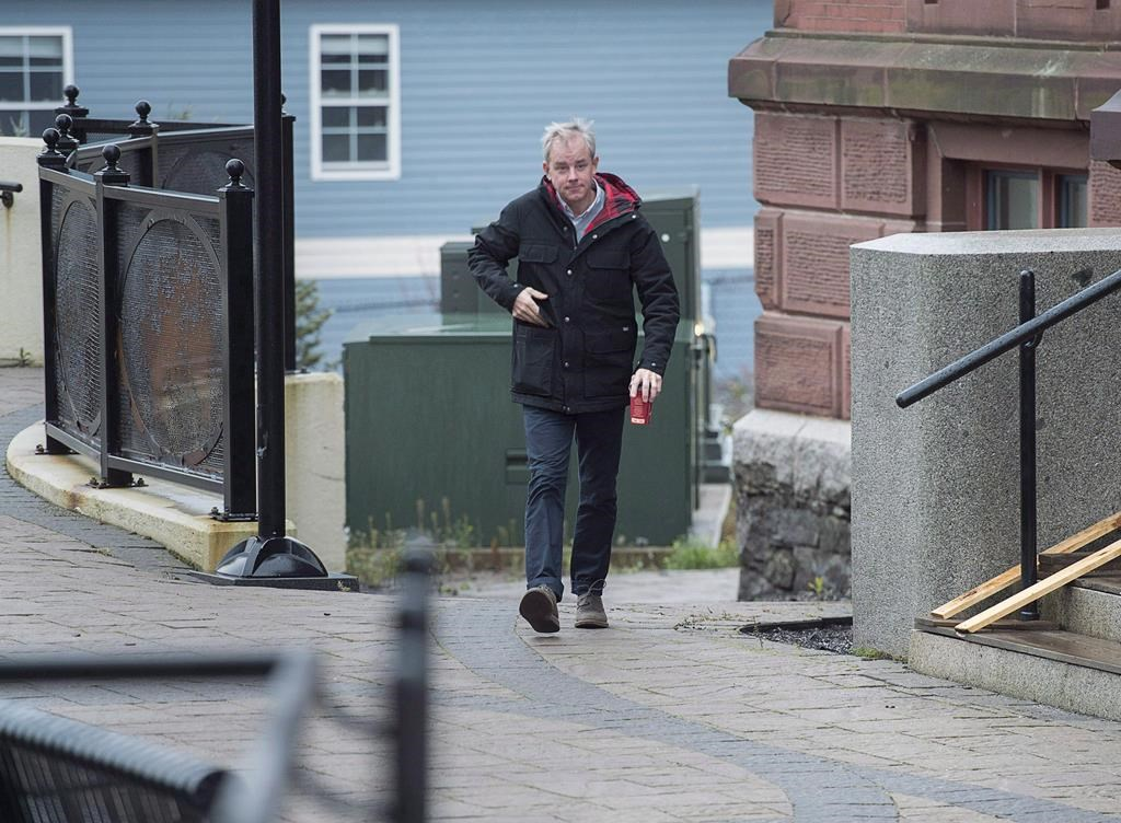 Dennis Oland walks to the Law Courts in Saint John, N.B., on Tuesday, Nov. 6, 2018.