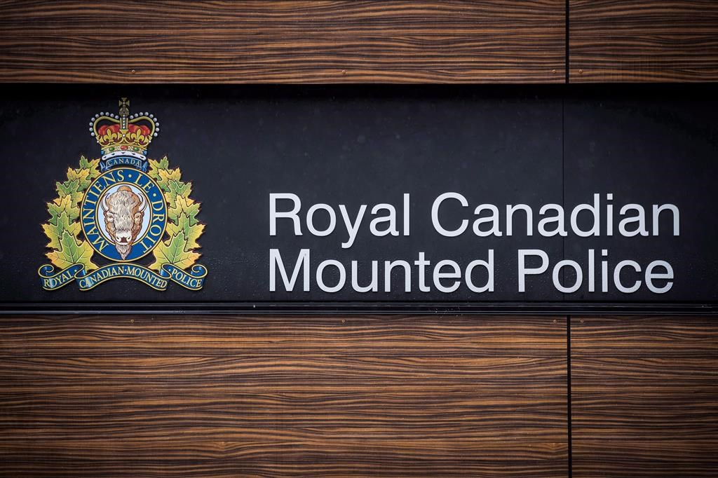 """The RCMP logo is seen outside Royal Canadian Mounted Police """"E"""" Division Headquarters, in Surrey, B.C., on Friday April 13, 2018."""