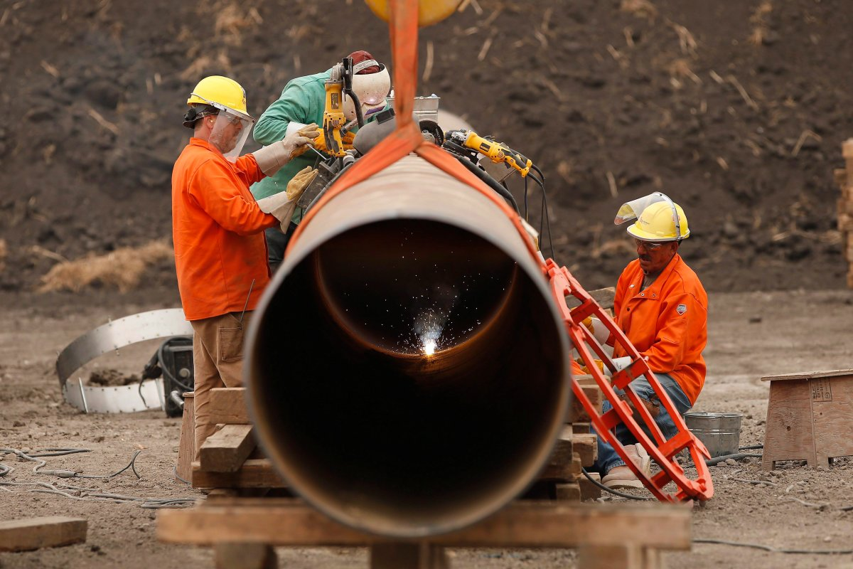 Enbridge workers weld pipe just west of Morden, Man., Thursday, Aug. 16, 2018.