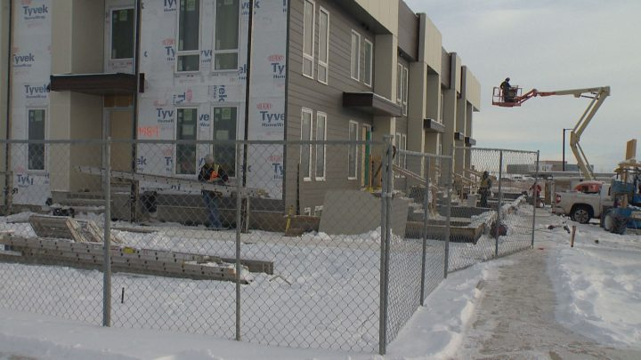 Multi-family housing construction going up in Calgary's SE during Alberta's downturn.