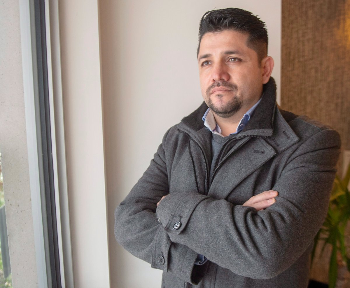 Hugo Ruiz at his home in Laval, Que., Friday, Nov. 30, 2018. Ruiz, who is a software engineer from Colombia, says he has trouble getting government help because he isn't on welfare.
