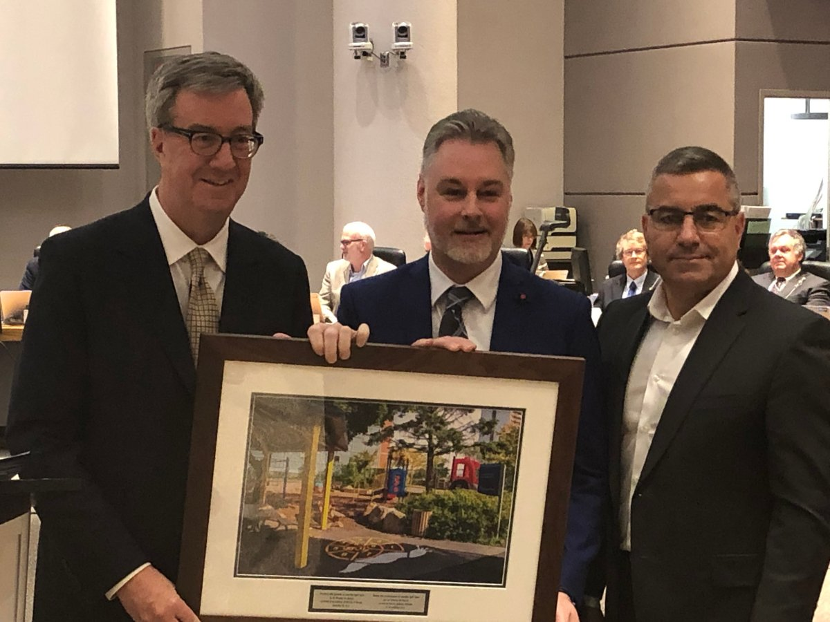 Mark Taylor (centre) accepts a photo from Mayor Jim Watson and city manager Steve Kanellakos as a thank you for his service on council at a ceremony before council on Nov. 28.