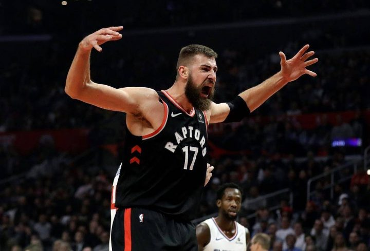 Toronto Raptors' Jonas Valanciunas (17) reacts after scoring against the Los Angeles Clippers during the first half of an NBA basketball game, Tuesday, Dec. 11, 2018, in Los Angeles.