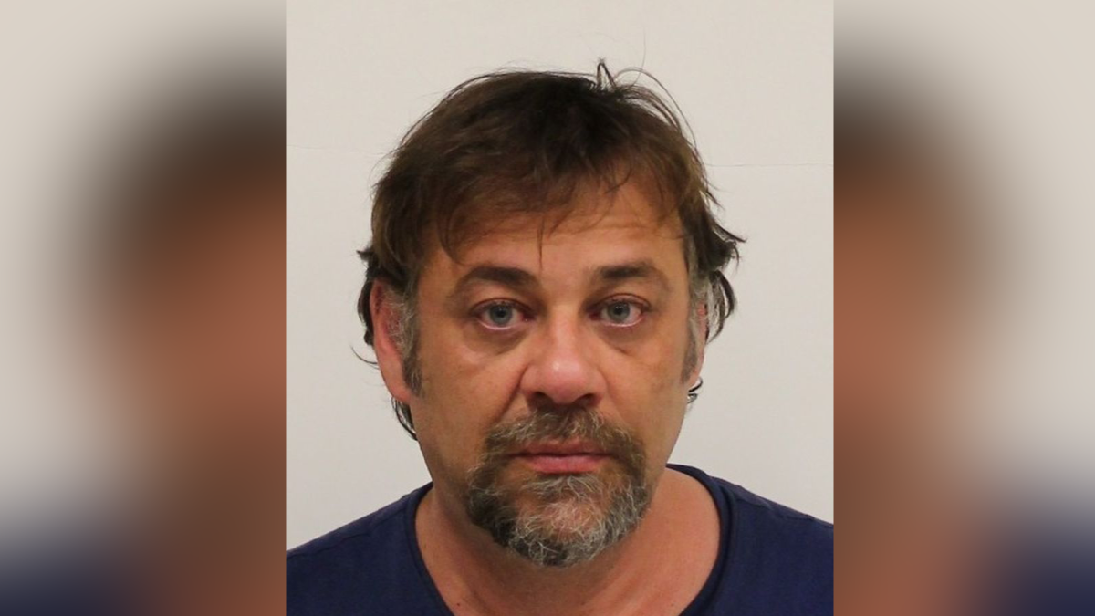 Michael Maletin, 48, has been charged with two counts of extortion and two counts of wearing a disguise with intent.