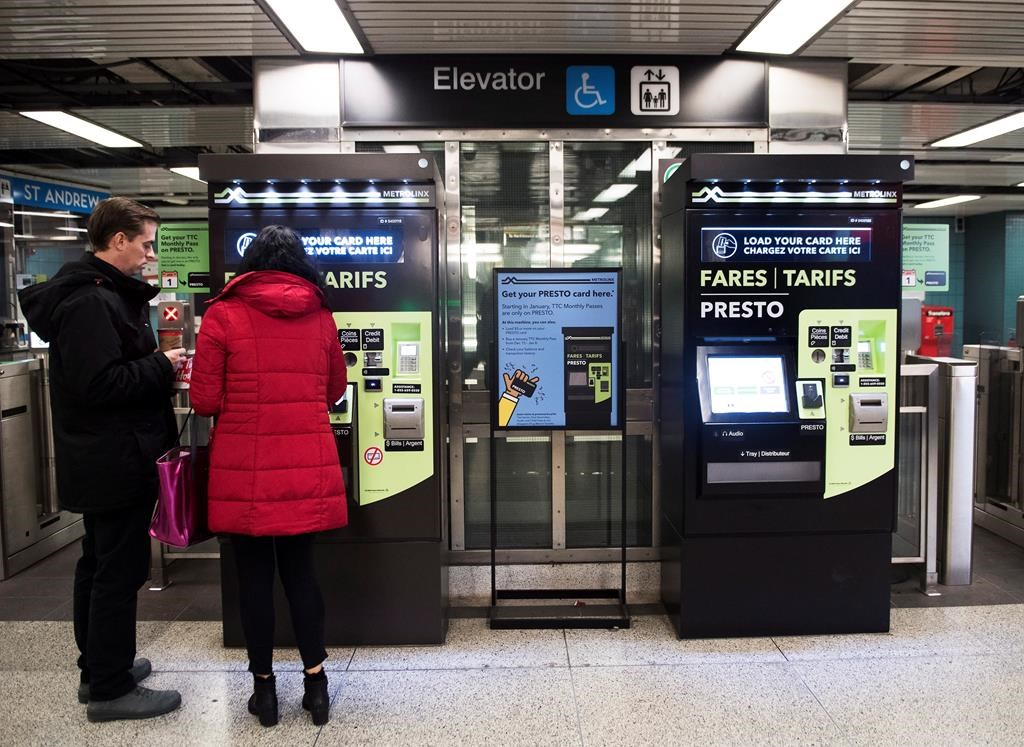 People pay at Presto machines underground in the TTC subway portals in Toronto on Tuesday, December 4, 2018. THE CANADIAN PRESS/Nathan Denette.
