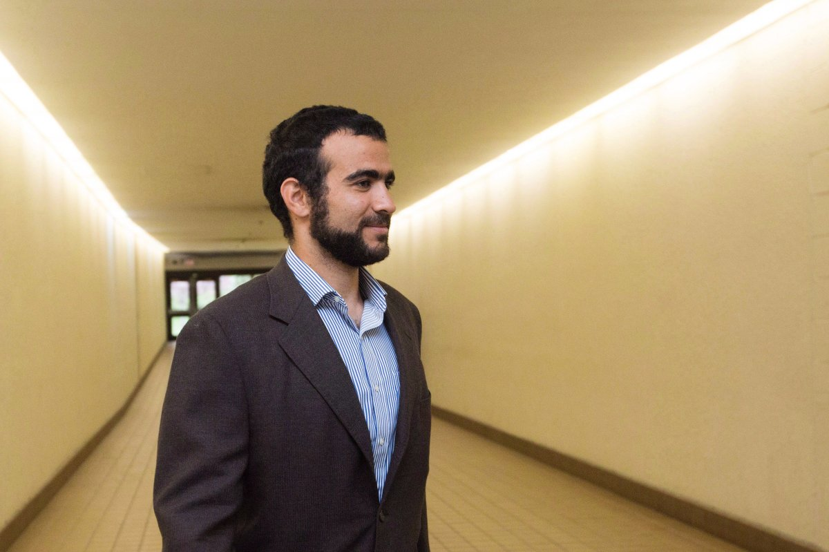 Omar Khadr leaves court after a judge ruled to relax bail conditions in Edmonton on Friday, Sept. 18, 2015. Former Guantanamo Bay detainee Omar Khadr wants to change some of the conditions of his bail, asking for a Canadian passport to travel to Saudi Arabia and requesting phone contact with his controversial sister.