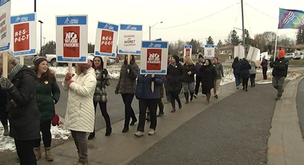 A few hundred union members show support for clerical workers after a wage freeze at PRHC.