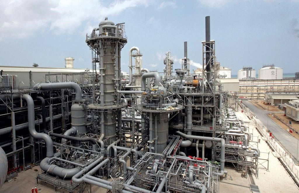 FILE - This April 4, 2009, file photo, shows a gas production facility at Ras Laffan, Qatar. The tiny, energy-rich Arab nation of Qatar announced on Monday, Dec. 3, 2018 it would withdraw from OPEC, mixing its aspirations to increase production outside of the cartel's constraints with the politics of slighting the Saudi-dominated group amid the kingdom's boycott of Doha. (AP Photos/Maneesh Bakshi, File).