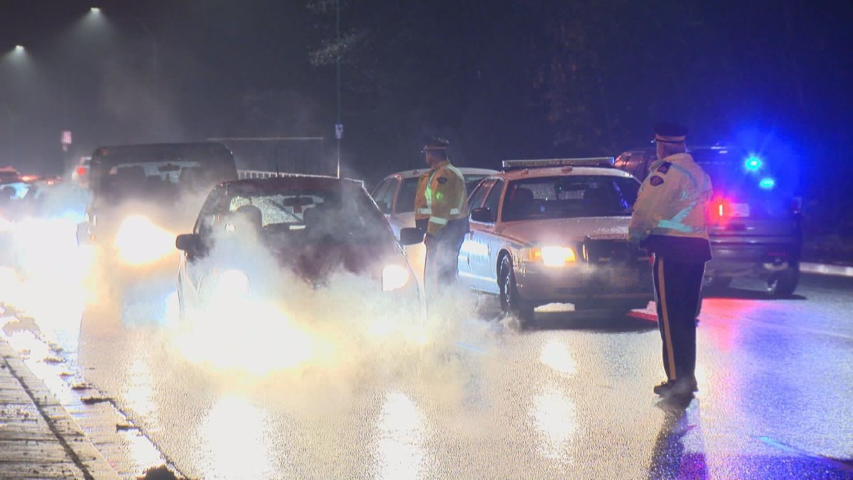 Police in British Columbia perform road checks.