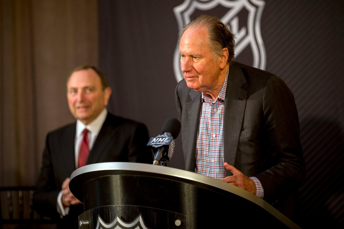 New Seattle hockey franchise majority owner David Bonderman, right, steps up to the podium after the National Hockey League Commissioner Gary Bettman, left, named Seattle as the league's 32nd franchise, Tuesday, Dec. 4, 2018, in Sea Island, Ga.