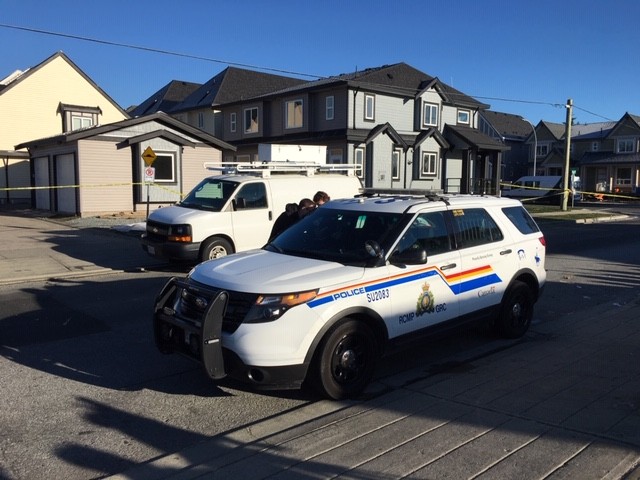 Surrey RCMP outside the home in Newton Friday morning.