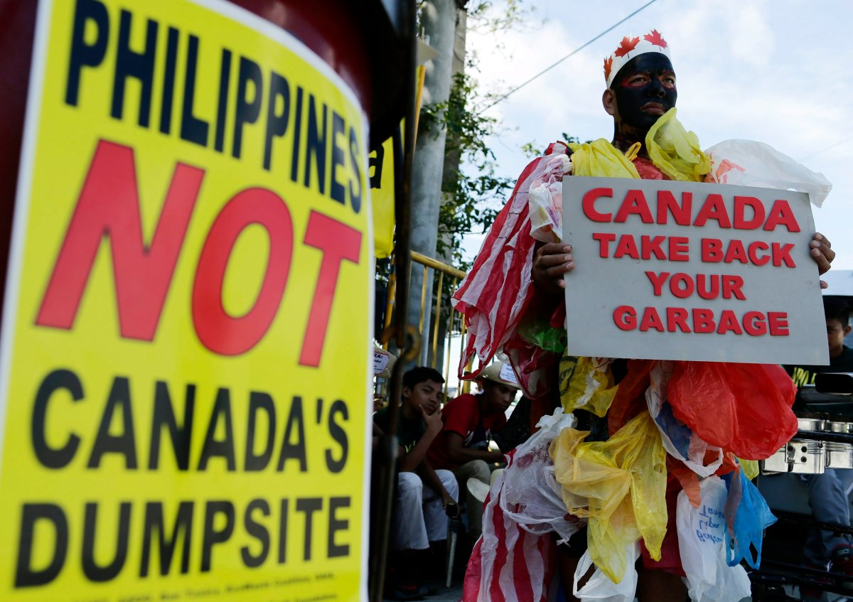 Filipino environmentalists hold a demonstration in front of the Senate building in protest of garbage imported from Canada.