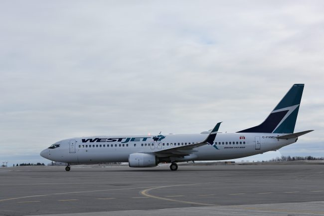 A WestJet Boeing 737 sits on the tarmac at Ottawa International airport in Ottawa, Ontario, March 11, 2018.