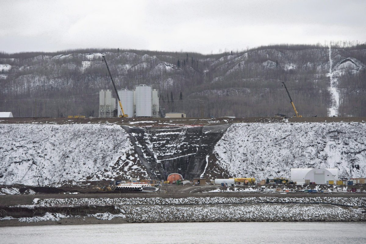 The Site C Dam location is seen along the Peace River in Fort St. John, B.C., on April 18, 2017. British Columbia's mammoth Site C hydro-electric project is seriously behind schedule, plagued by quality problems and marked by secrecy, says an assessment by an international dam expert. THE CANADIAN PRESS/Jonathan Hayward.