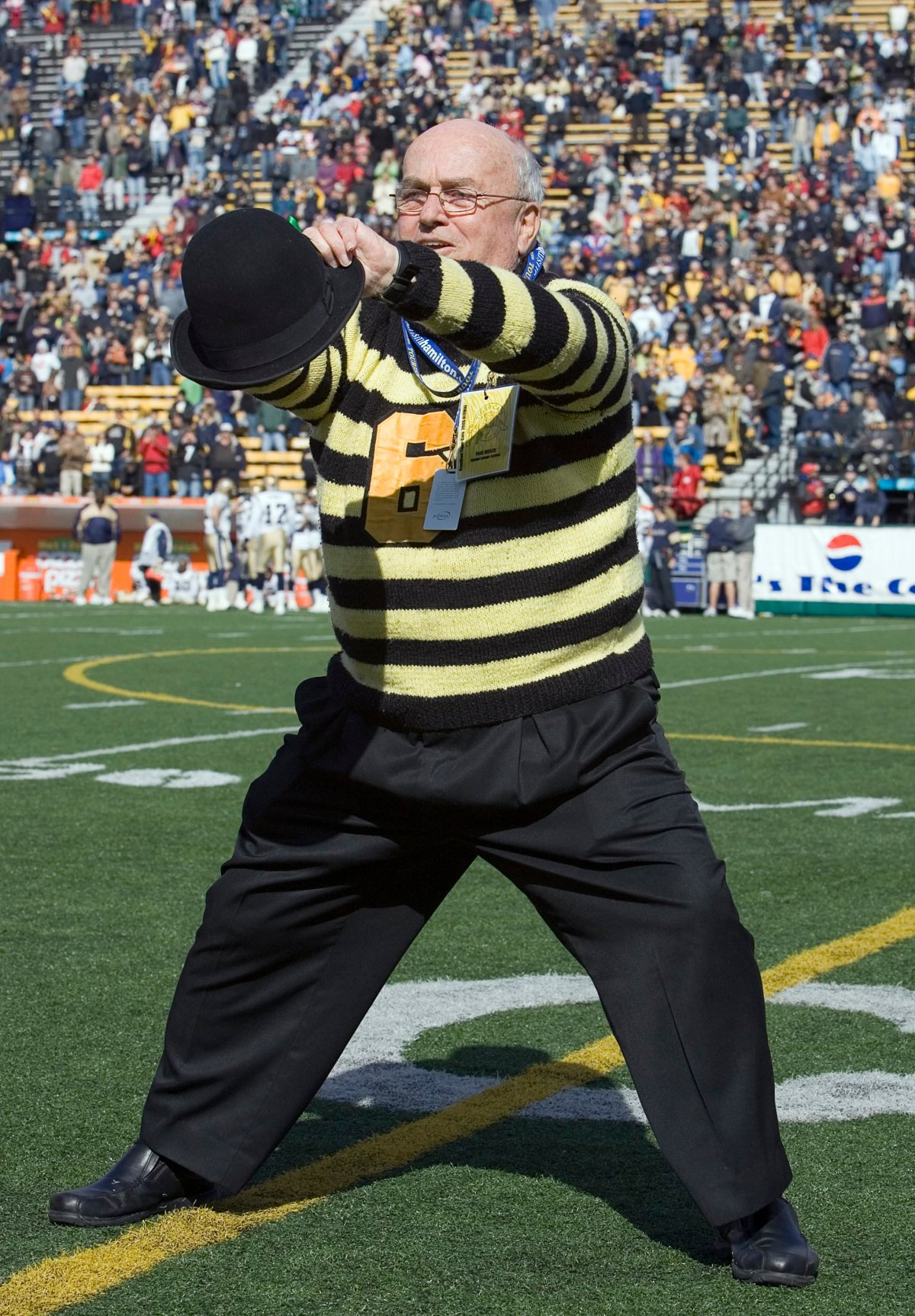 """Paul Weiler leads the famous """"Oskee Wee Wee"""" cheer as Pigskin Pete during CFL action between the Hamilton Tiger-Cats and the Winnipeg Blue Bombers in Hamilton, Ont., on Sunday, Oct. 15, 2006. The game was Weiler's last."""