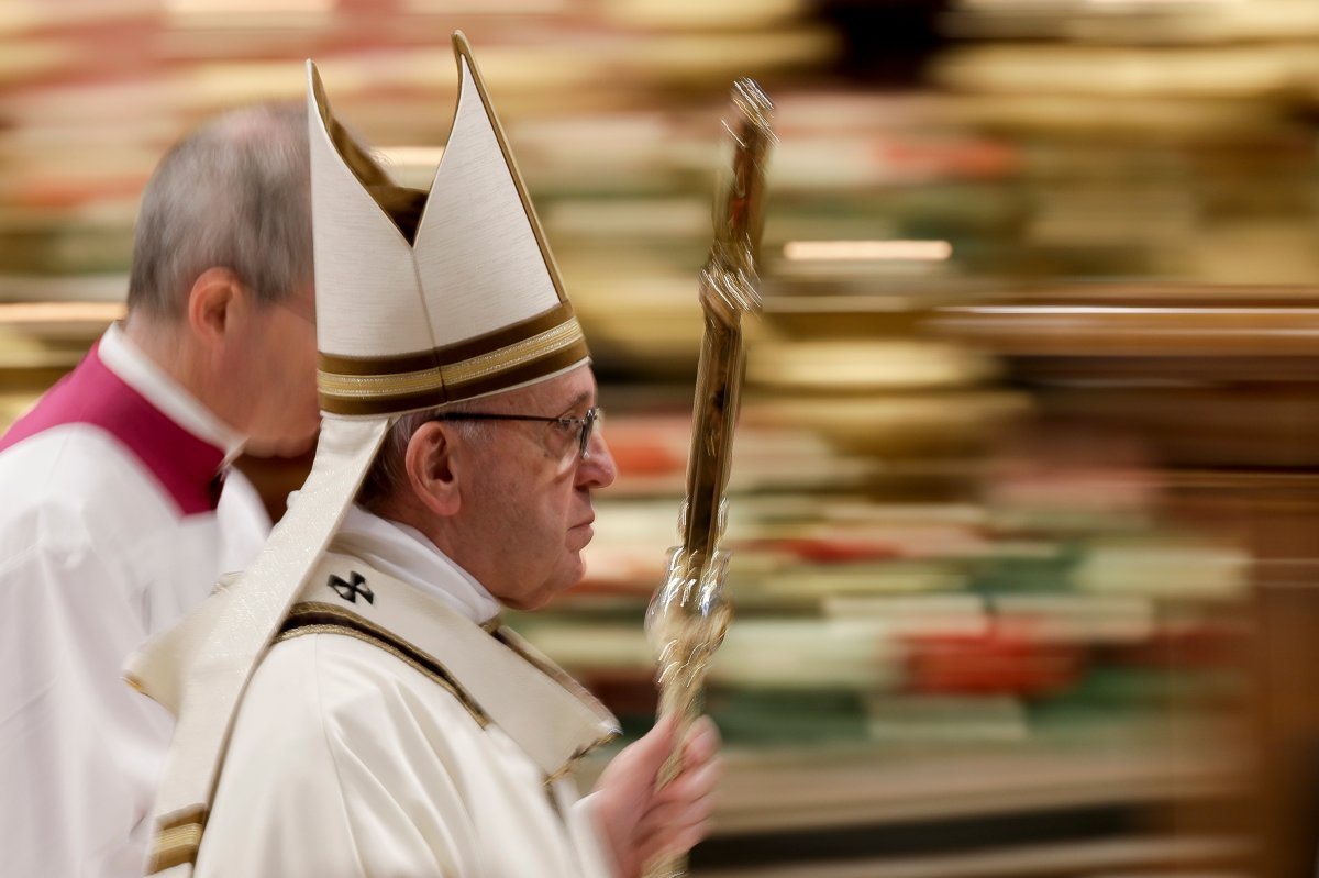 In this photo taken with slow shutter speed Pope Francis leaves after celebrating an Epiphany Mass in St. Peter's Basilica at the Vatican, Sunday, Jan. 6, 2019.