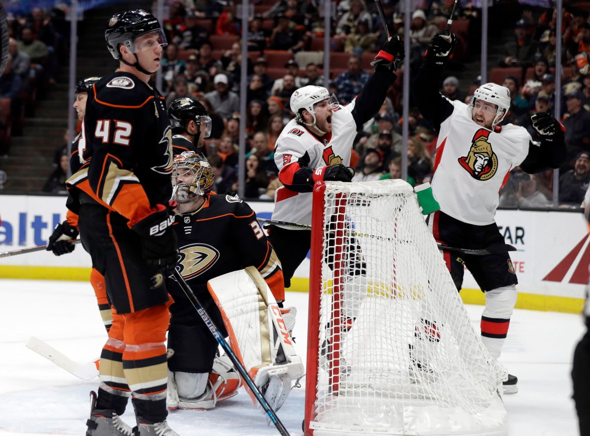 Ottawa Senators' Bobby Ryan, center, celebrates his goal with teammate Chris Tierney, right, during the third period of an NHL hockey game against the Anaheim Ducks Wednesday, Jan. 9, 2019, in Anaheim, Calif.