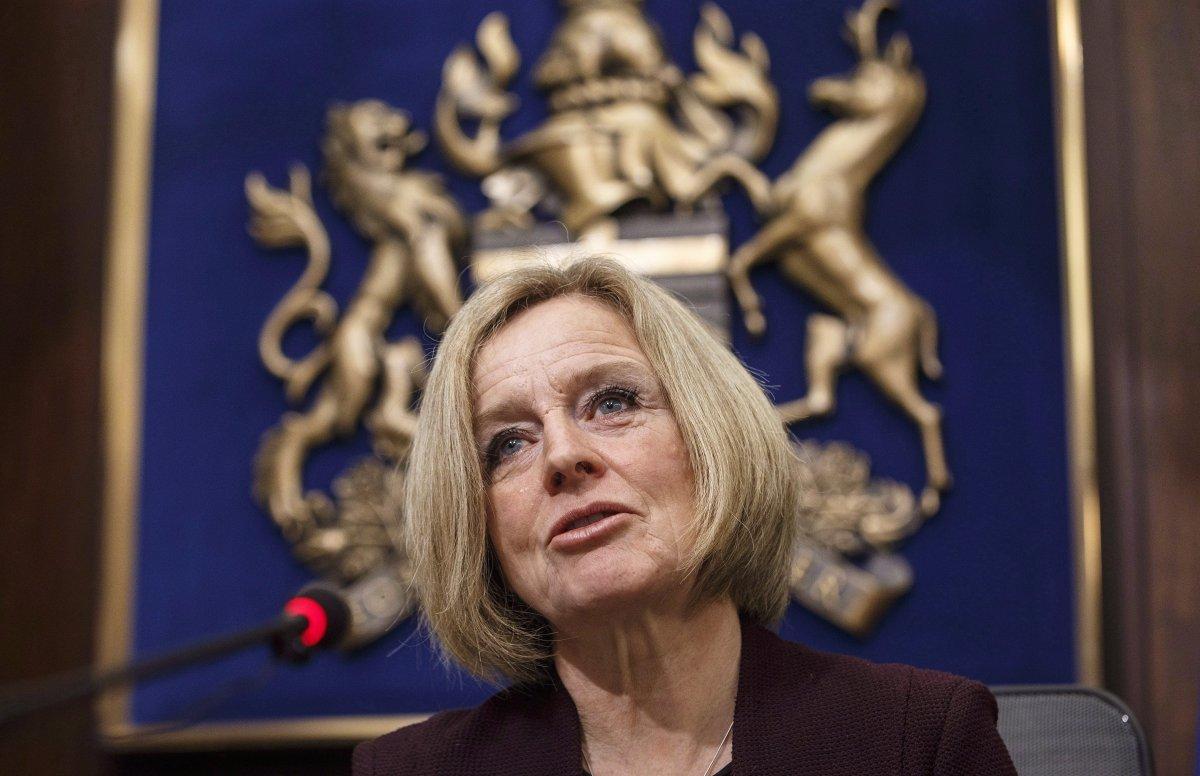 Alberta Premier Rachel Notley speaks to cabinet members in Edmonton on December 3, 2018.