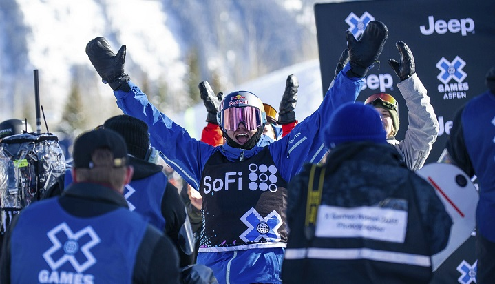Canada's Mark McMorris raises his arms after seeing his winning score from this third run in the men's snowboard slopestyle final at the X Games on Saturday, Jan. 26, 2019, in Aspen, Colo.