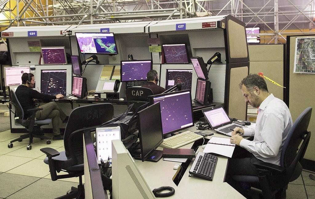 NAV Canada air traffic controllers monitor air traffic at the NAV Canada control centre in Montreal on March 2, 2018.