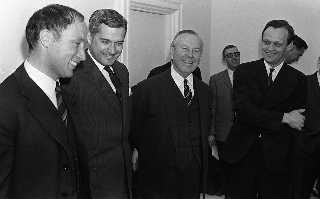 Prime Minister Lester B. Pearson (second right) and cabinet ministers Pierre Trudeau (left to right) John Turner, and Jean Chretien talk in Ottawa on April 4, 1967.