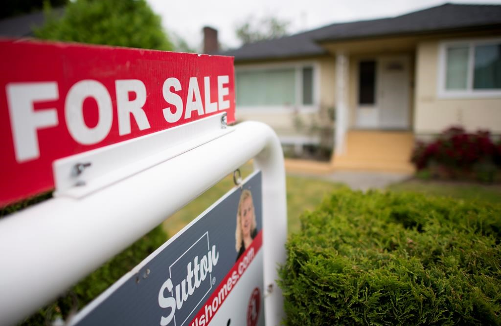 A real-estate sign is pictured in Vancouver, Tuesday, June 12, 2018. The local real-estate board says home sales in Metro Vancouver in 2018 were the lowest since 2000.