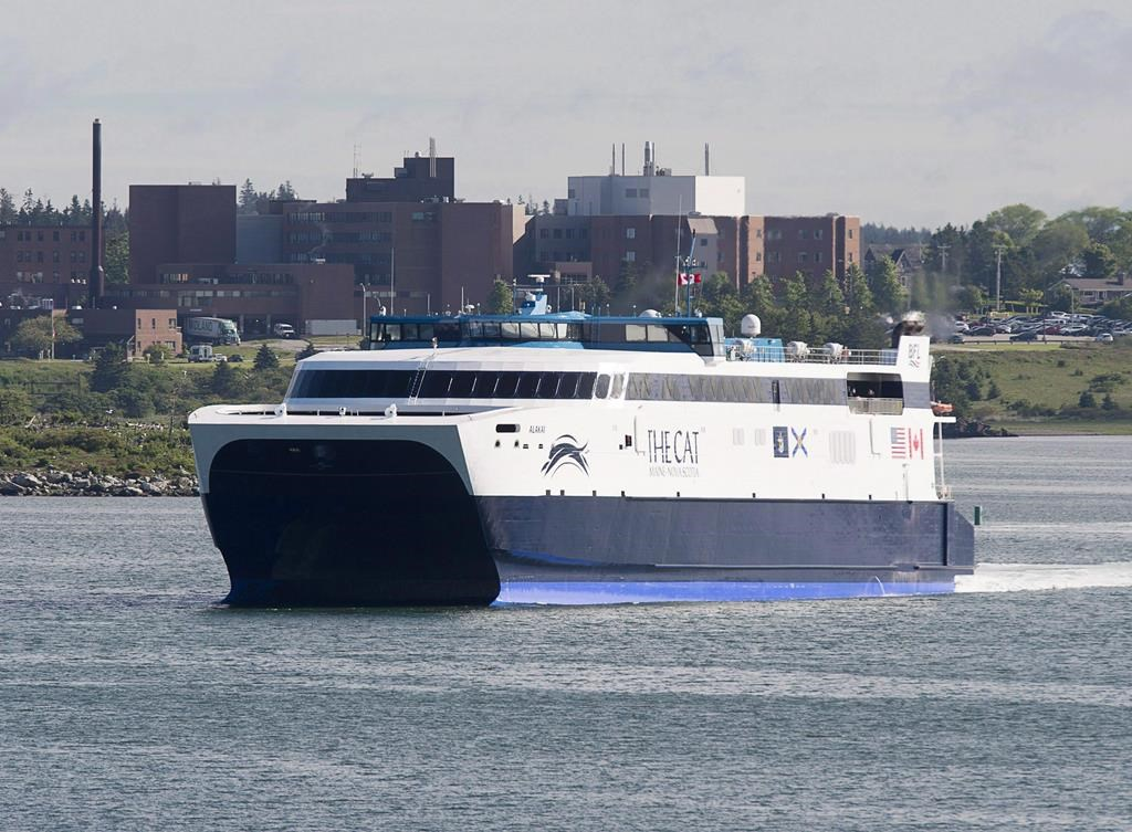 The CAT, a high-speed passenger ferry, departs Yarmouth, N.S. heading to Portland, Maine, on its first scheduled trip on June 15, 2016. The private operator of the Nova Scotia-Maine ferry says its move to a new port in the state is being held up by the U.S. government shutdown and the transition to a new governor. THE CANADIAN PRESS/Andrew Vaughan.