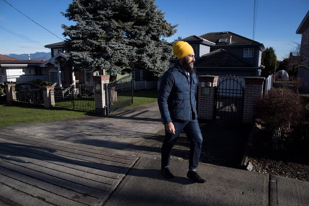 NDP Leader Jagmeet Singh door knocks for his byelection campaign, in Burnaby, B.C., on January 12, 2019. Housing is shaping up to be a defining issue in the byelection, set for Feb. 25, and in the federal election later this year. In Burnaby, renters have been kicked out of older apartments to make way for luxury condos, and sky-high prices are shutting millennials out of the market. THE CANADIAN PRESS/Darryl Dyck.