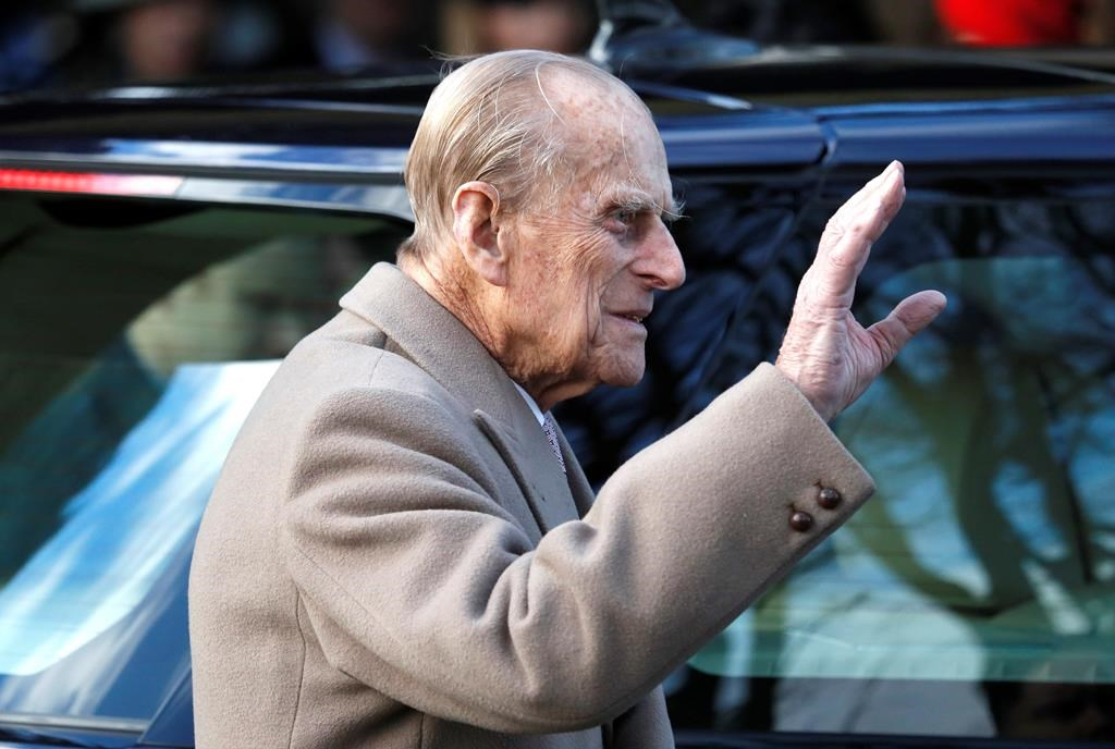 FILE - In this Sunday, Dec. 25, 2016, file photo, Britain's Prince Philip waves to the public as he leaves after attending a Christmas day church service in Sandringham, England.