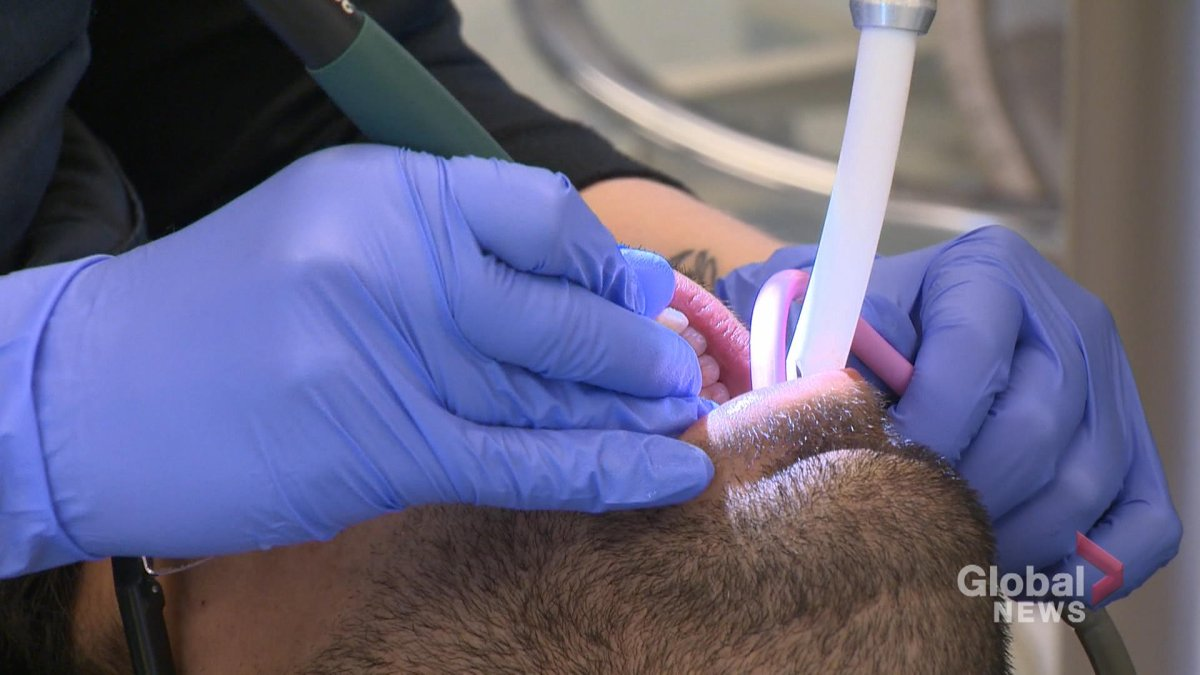 A man undergoes a dental cleaning.