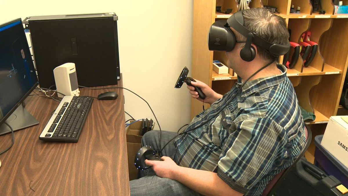 Michael McCready shows off the virtual reality technology for anyone in the Lethbridge College book club.
