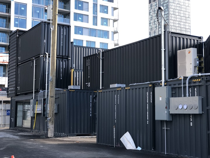 """These shipping containers will soon play host to a variety of restaurants, bars, and shops as a part of the new """"Stackt"""" market."""