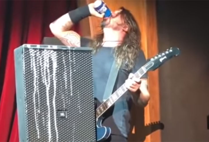 Foo Fighters' frontman Dave Grohl slams a beer during a show in Las Vegas.